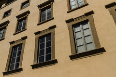 Old residential building front in narrow street, Florence. Stock Images