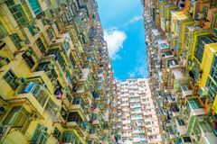 Old residential building under blue sky in Hong Kong. Old residential building under blue sky at Quarry Bay, Hong Kong Stock Image