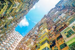 Old residential building under blue sky in Hong Kong. Old residential building under blue sky at Quarry Bay, Hong Kong Stock Images