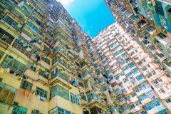 Old residential building under blue sky in Hong Kong. Old residential building under blue sky at Quarry Bay, Hong Kong royalty free stock photo