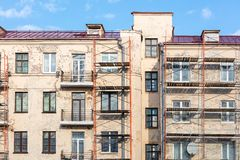 Old residential building under reconstruction. blue sky background stock image