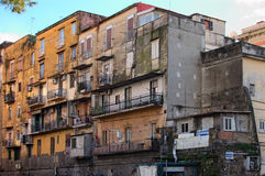Old residential buildings. The facade of the house needs repair.  Royalty Free Stock Photos