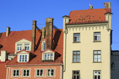 Old residential house on Livu square. Old Riga, Latvia. Old residential house on Līvu square with pigeons on the tiled roof. Old Riga, Latvia Royalty Free Stock Images