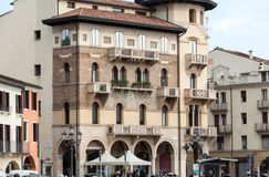 The old residential houses decorated with mosaic tiles and pattern maid from bricks, Prato della Valle,  in Padua Stock Photography