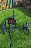 Old restaurated farm equipment cart Stock Images