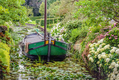 Old restored barge in a narrow canal Royalty Free Stock Photo