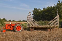 Old restored Case tractor pulling a hayrack. ROLLAG, MINNESOTA, Sept 3. 2017: A restored Case tractor pulling a straw rack for hauling bundles is ready for field Stock Photo