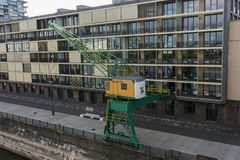 Old restored crane and modern building at the Rhine in Cologne. Germany Stock Images
