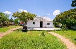 Old restored slave house. Very old restored slave on curacao on a sunny day Royalty Free Stock Image