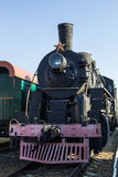 Old restored steam train with wagons Royalty Free Stock Photo