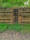 Old retaining wall with many holes to drain stock images