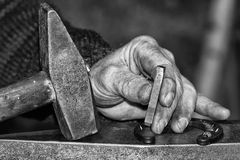 Old retired man hands working in b&w Stock Photos