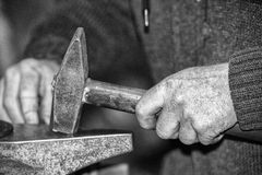 Old retired man hands working in b&w Stock Photography