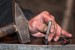 Old retired man hands working Stock Photo