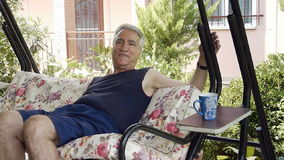 Old retired man on swing stock footage