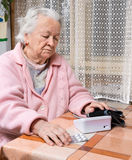 Old  retired woman taking blood pressure Stock Image