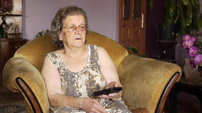Old retired woman watching television stock video footage