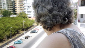 Old retired woman watching traffic stock video
