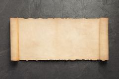 Old retro aged paper parchment on slate. Stone background, top view stock photo