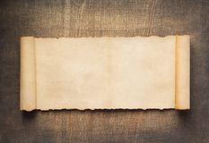 Old retro aged paper parchment at wood. En background stock photography