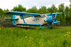 Old retro airplane on green grass Royalty Free Stock Image
