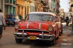 Old American car in Havana. An old retro american car driving on the street in the Cuban capital Havana, December 2013 Stock Photography