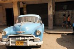 Old retro american car on street in Havana Cuba. Old retro american car driving on street in Cuban capitol city Havana, Havana , December 2013 Royalty Free Stock Photography