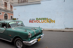 Old retro american car on street in Havana Cuba. Old retro american car driving on street in Cuban capitol city Havana, Havana , December 2013 Stock Photography