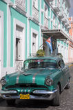 Old retro american car on street in Havana Cuba. Old retro american car driving on street in Cuban capitol city Havana, Havana , December 2013 Stock Images