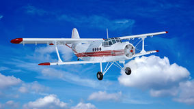 Old retro bi plane fly in the clouds. Royalty Free Stock Photography