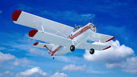 Old retro bi plane fly in the clouds. Royalty Free Stock Images