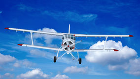 Old retro bi plane fly in the clouds. Stock Images