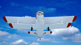 Old retro bi plane fly in the clouds. Royalty Free Stock Photo
