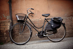 Old retro bicycle with basket in Italy Royalty Free Stock Photos