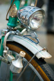 Old retro bicycle. Front macro view with dynamo, front wheel and headlight Royalty Free Stock Photo