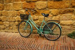 Old bicycle near red brick wall royalty free stock photo