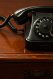 Old retro black telephone on desk Royalty Free Stock Photo
