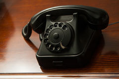 Old retro black telephone on desk Royalty Free Stock Photo