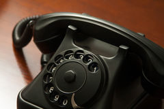Old retro black telephone on desk Stock Image
