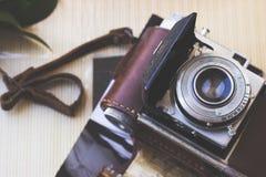 Old retro camera on aged photo album stock images