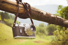 Old retro camera. On the background of the Carpathian Mountains stock photography