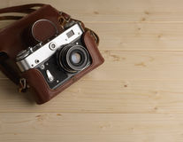 Old retro camera. On background of wooden boards Royalty Free Stock Photo