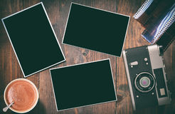 Old retro camera with black photographs Stock Photography