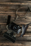 Old retro camera on brown wooden background. Stock Photo