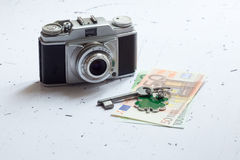 Old retro camera with euro banknotes Royalty Free Stock Image