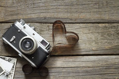Old retro camera with heart love photography concept Royalty Free Stock Images