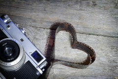 Old retro camera with heart love photography concept Royalty Free Stock Photos