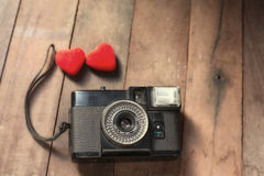 Old retro camera with heart love photography creative concept Royalty Free Stock Images