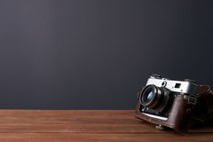 Old retro camera in leather case Stock Image