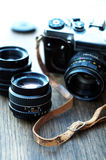 Old retro camera and lens Royalty Free Stock Photography